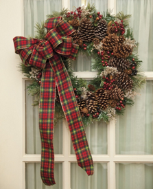 finished pine cone wreath hanging on a door