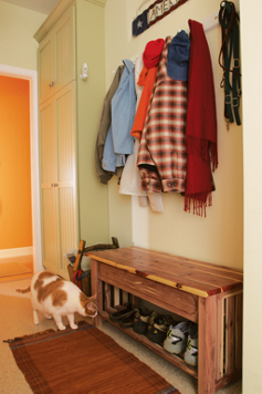 a mudroom corner in an entrance hallway