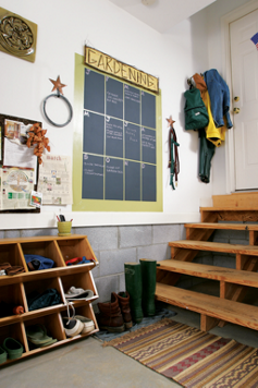 A mudroom corner in a garage - Tractor Supply Co.