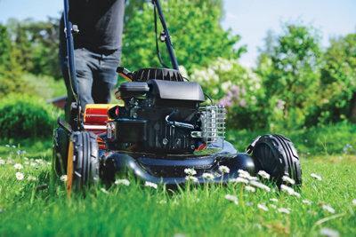 working mower viewed at grass level