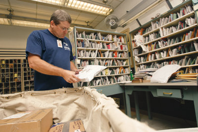 Rick sorting mail in the mailroom