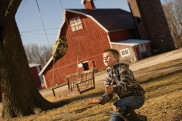 Cole playing in front of the barn