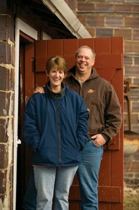Todd and Mary Kay standing in front of their barn