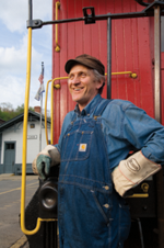 Artie leaning on the end of a box car