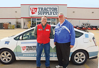 Cliff Ricketts and Arthur Mitchell in front of Cliff's hydrogen-powered car - Tractor Supply Co.