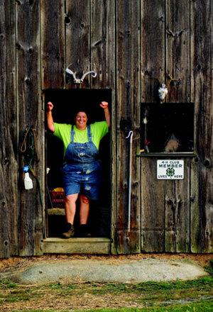 Sandra Miller standing in the doorway of her barn
