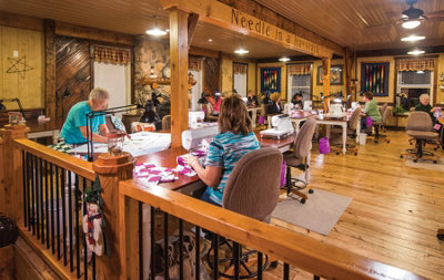 quilters working around various sewing tables