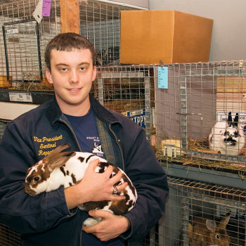 Brook holding one of his rabbits