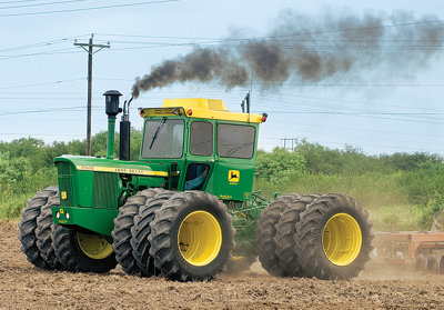 The restored tractor hard at work