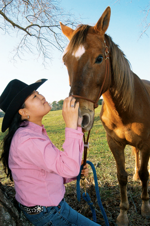 Rebecca with one of her rescued horses