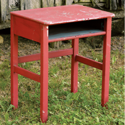 an old school desk, painted red