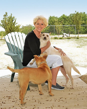 Sandy with a couple of rescued dogs
