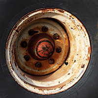 rusty wheel well before blasting