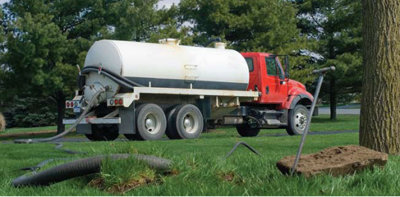 tanker trunk pumping a septic tank