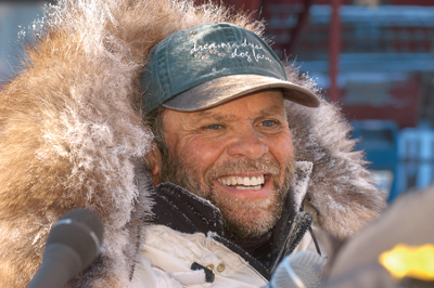 Van Halter with baseball cap and heavy winter coat
