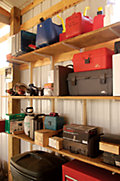 shelving in a shed with neatly organized toolboxes and other containers