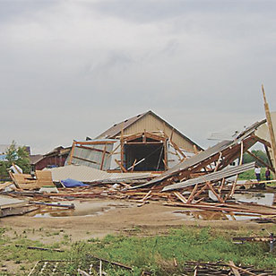 debris from destroyed building(s) on the ground