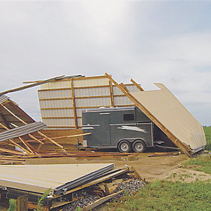 horse trailer covered in debris