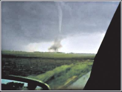 a tornado viewed through a vehicle windshield
