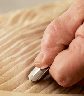 a close-up shot of working on a carved piece