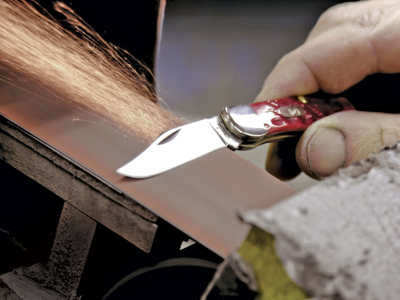 a knife being sharpened (sparks flying)