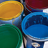 different colors of paint in open cans