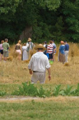 an interpreter walking towards a group of tourists