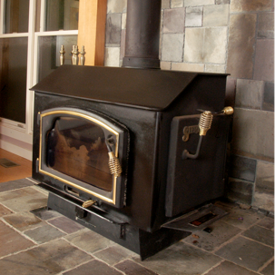 a wood stove on gray brick
