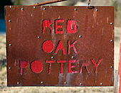 the sign for Red Oak Pottery