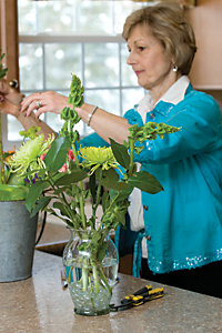 use large, colorful flowers, then filler flowers