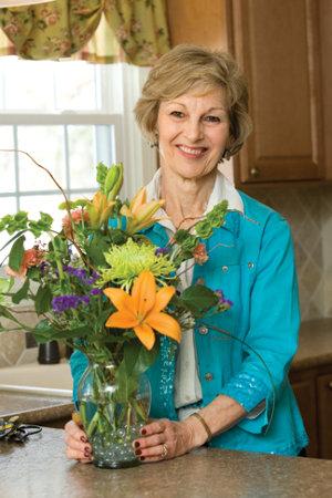 Sharon Yantis with a flower arrangement