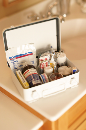a first-aid kit on the corner of a bathroom vanity