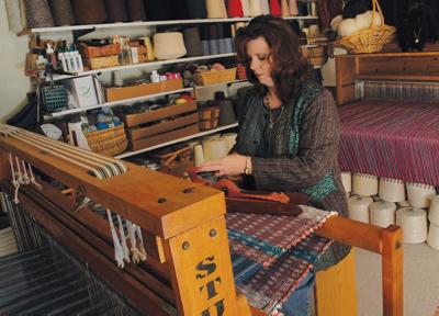 Karen weaving at one of her looms