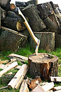 an axe stuck in a chopping block