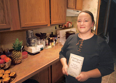 Wendy Whipple with her family cookbook