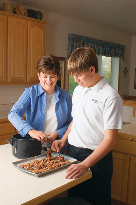 Forrest and his mom making no-bake oatmeal cookies