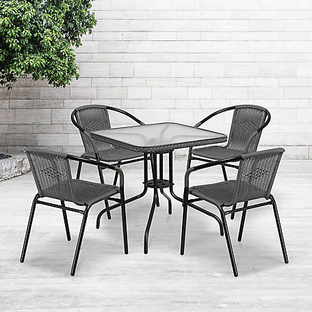 28 in. Square Glass Metal Table with Rattan Edging and 4 Rattan Stack Chairs